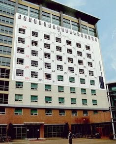 Creative way to reach the target audience of axe body spray (college age males). Covered an all female dorm to look like a calendar implying that Axe can help you meet a new girl each day. Fits very well with their television campaigns.10 Clever Ads on Buildings - Oddee.com (clever ads, ads on buildings)