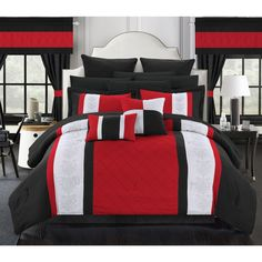 Black, red and white color blocks top this stunning polyester 24 piece bedroom set. This elegant set is conveniently machine washable. Subtle floral designs and pintucks complete the look.