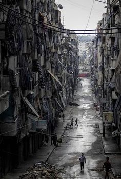 4)By using a high camera angle gives a point of you that the viewer is looking down at it. It creates a sense the place is a low place eg; third world, down in the dumps etc. which communicates it to be poor, impoverished.