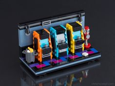 https://flic.kr/p/DcF2yV | My Old Arcade: Power-Up Edition | I felt it was time to expand my minifig arcade vignette. Building guide now available at chrismcveigh.com