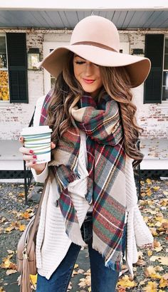 #fall #outfits women's red, teal, red, and black plaid scarf and peach sunhat