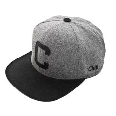 Block C Wool Cap by Chill Apparel.  Flat bill and a leather strapback with a metal buckle. Inspired by old school baseball style caps. This classic wool cap can be a staple piece for any wardrobe.