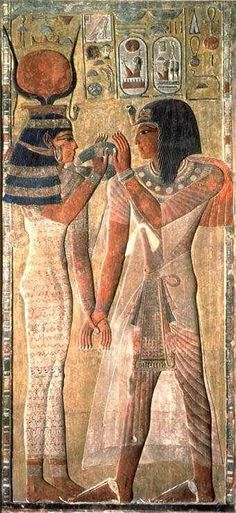 During the New Kingdom, men and women wore sheer pleated gowns. The person on the left also looks like he is wearing a Uraeus on his head. (Egypt)