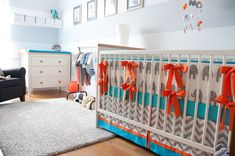 Cute! Love the mix and match elephant bedding by Little Charlie May - orange-aqua -gray www.etsy.com/shop/LittleCharlieMay