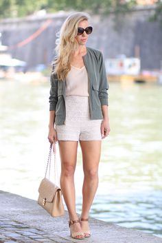 Olive & Ivory: J. Crew olive silk bomber jacket, high-waist lace shorts, neutral block-heel sandals, Louis Vuitton St. Germain bag dune leather, neutral colors outfit, bomber jacket outfit