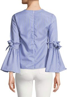 Shop Pinstriped Bow-Sleeve Blouse from Haute Rogue at Neiman Marcus Last Call, where you'll save as much as on designer fashions. Skirt Fashion, Hijab Fashion, Fashion Dresses, African Fashion Traditional, Punjabi Suit Neck Designs, Sleeves Designs For Dresses, Party Wear Lehenga, Pretty Outfits, Blouse Designs