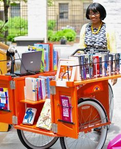 Create innovative programs to promote the library's services in the community, such as this Book Bike service launched by the Cleveland Public Library.