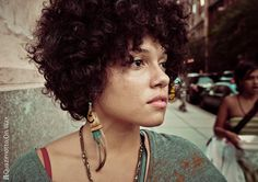 short hair / curly / freckles / feather earrings / cute