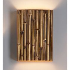 http://www.fabby.com/wall-sconce/faux-finishes/10-thin-bamboo-reed-wall-sconce-gold-finish.html