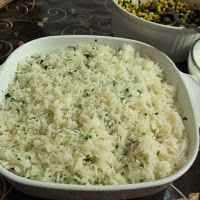 Cilantro Lime Rice     2 cup basmati rice  4 cups water    Bay leaf    1 tsp salt    Juice of a lime    2 tbsp cilantro, minced    2 tbsp oil