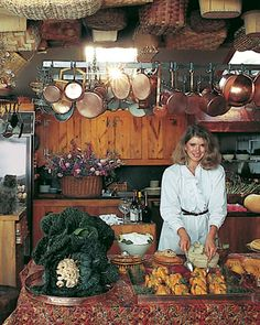 """The First Kitchen Renovation  Andy and I originally concentrated on creating a large kitchen with a dining area; the sycamore wood for the cupboards came from Massachusetts, and I found the pot rack at a tag sale -- a nearly identical picture was the opening spread of my 1982 book, """"Entertaining."""""""