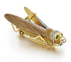 18kt Yellow Gold, Diamond and Emerald Lady's Grasshopper Brooch. Having two marquise faceted emeralds as eyes. Accented by approx. 68 full cut diamonds.