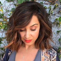 Dark brown hair with face framing chocolate and caramel balayage on choppy bob