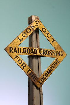 Look out for the locomotive Railroad Crossing sign