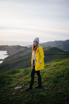 Julia from Gal Meets Glam wearing our iconic yellow raincoat in San Francisco
