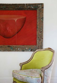 An antique chair reupholstered in map-printed fabric and acid-green velvet looks even more compelling next to a deep-red painting. Interior Design Vignette, House Worth, Beach Cottage Style, Red Walls, Take A Seat, Color Stories, Slipcovers, Upholstery, Art Pieces
