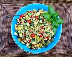 Summer Corn Salad with tomatoes, red bell pepper, black olives, oranges, avocado, cucumber, grilled zucchini, basil & feta...the flavors of summer in one bite! #vegetarian #glutenfree #Calaisio