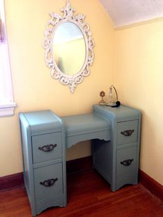 A $20 waterfall dresser I sanded and painted an antique blue. Goes well with my French vintage mirror!