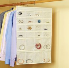 I've had this double sided hanging jewelry organizer for several years, and it's the bomb. You can find it at Lillian Vernon for $12.98