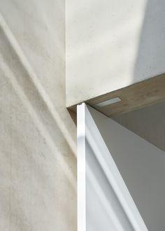 Modern, minimalist, flush mounted door hinges. No doorframe.