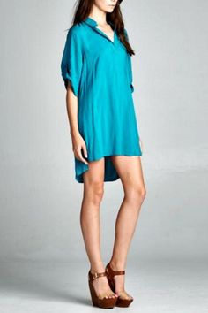 Collared tunic has tabbed sleeve and a banded V neck and oversize fit. Tunic has a hi-lo hem. This amazing tunic in deep turquoise can be belted and worn over leggings for a simple but comfy way to celebrate the season! Effortlesscomes to mind when we picture ourselves wearing this beauty.   Weekend Tunic by Twist. Clothing - Dresses - Casual Santa Monica, Los Angeles, California