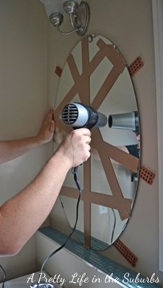 How to get a builder mirror off the wall with no holes! Because my house is full of these