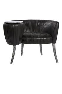 KELLY WEARSTLER   BLACK LEATHER SOUFFLE COCKTAIL CHAIR. Detailed chair has a small, attached tabletop and tapered legs, all constructed of hand-cerused oak.