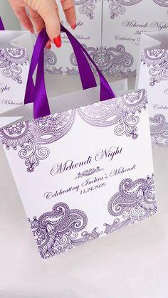 Elegant personalized Mehendi Night Gift bags with purple satin ribbon handles. Indian wedding welcome bags. Mehndi night gift bags for guests. #mehendidesigns #mehendi #mehndi #mehndinight #mehendinight #weddingfavors #weddingwelcomebags #weddingideas #elegantwedding #sangeet #hennanight #mehendiart #giftbags #weddinggifts #indianwedding #weddingcolor #purplewedding