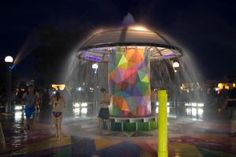"""The 20-foot lighted fountain, known informally as the """"mushroom,"""" provided a cool break from the heat of the day, as well as a place to shower. There was also a Ferris wheel that offered attendees a fun ride and great views."""