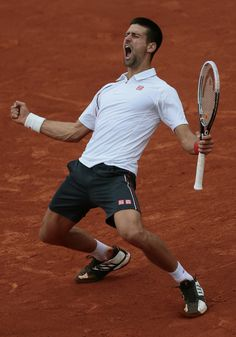 He's got a tennis player's build- not surprising, as it's one of his past times. (Serbia's Novak Djokovic Celebrates)