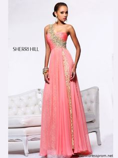 Size 8 Coral/Gold In StockThis breathtaking Sherri Hill formal piece 1593 is the most wanted in the prom fashion list! Embroidery and beads bring to life an exquisite single shoulder strap that stretches diagonally over the finely ruched empire bodice with sweetheart neckline. The A-line shape underskirt features hand-embroidery all over it and is delicately covered by a diaphanous overlay that splits on side elegantly. This glamorous prom gown is available in Coral/Gold. Swarovski crystal…