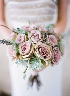 dusty pink #bouquet, photo by Natasha Hurley http://ruffledblog.com/winter-whites-wedding-inspiration #weddingflowers #roses
