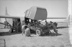 Planning and Preparations January - July 1943: A jeep is loaded onto an American WACO CG-4A glider.