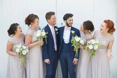Grooms wearing Memory Lane Roses with Lavender and Rosemary. Bridesmaids flowers of White Ohara roses, White Astible, White Astrantia and hanging Amaranthus. Image taken by Natalie J Wedding photography. Flowers created by Eden Blooms at Northbrook Park