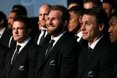 L to R, Richie McCaw, Kieran Read and Ben Smith look on during the New Zealand All Blacks Rugby World Cup team announcement at Parliament House on August 30, 2015 in Wellington, New Zealand.