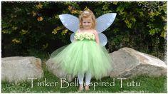 girl wearing a tinkerbell tutu costume