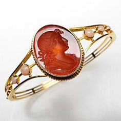 This antique bangle bracelet is crafted of yellow gold and features a carnelian intaglio center stone with pink coral cabochon accents. Oval cameo: 21 x mm Coral Bracelet, Coral Jewelry, I Love Jewelry, Bangle Bracelets, Jewelry Accessories, Fine Jewelry, Jewelry Design, Bangles, Bracelet Box