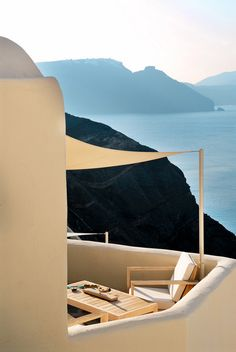 Mystique at Santorini, built into Oia's famed cliffs. The intricate system of caves includes a spa and the Secret Wine Cave, an amazing place for a private candlelit dinner.