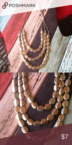 Three Strand Silver Tone Necklace This charming little piece gives you that layered look all in one. Actually it can be paired with a longer necklace for added drama. It's very cute on and pops against your LBD or your crisp cotton button down shirt! Jewelry Necklaces
