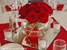 Centerpiece @ Foxtail Club summer wedding.  Red roses in fishbowl. Sonoma County wedding flowers by The Wild Orchid. wildorchid707.com