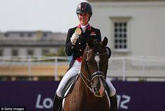 Look, I've got another one: Charlotte Dujardin celebrates winning her second medal