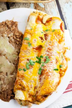 Three Cheese Enchiladas Recipe -Perfect for a meatless Monday vegitarian dinner recipe and a cheese lover's dream, these Three Cheese Enchiladas are filled with cheese, smothered in enchilada sauce, and baked in the oven for a delicious family meal.