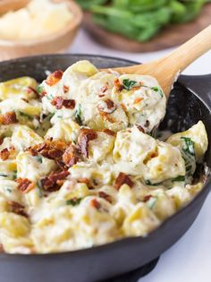 Tortellini Al Forno. This Tortellini Al Forno features stuffed tortellini tossed in a rich and creamy garlic cheese sauce and topped with crumbled bacon. Chicken Tortellini, Cheese Tortellini Recipes, Chicken Bacon, Pasta Recipes, Dinner Recipes, Cooking Recipes, Healthy Recipes, Dinner Ideas, Spaghetti