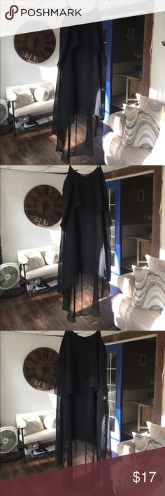 Black hi-low dress Simple black hi-low dress.  Only worn once to a wedding as a guest.  I belted with a slimy black belt for a defined waist and it looked awesome.  Excellent condition from non smoking home! Soprano Dresses High Low
