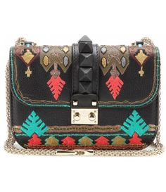 Maybe it's not exactly Southwestern, but it would go... with alot of stuff!  I mean, look at it!!  Gorgeous purse here, people!  Hahaha