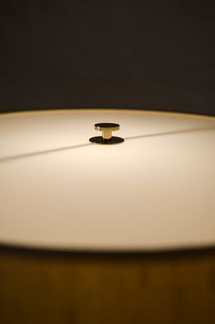 Bergboms floor lamps in brass and beige lamp shades at Studio Schalling #midcentury #design #lighting