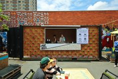 Melbourne's pop-up People's Market opens in Collingwood for a short time only. Shipping Container Cafe, Shipping Container Conversions, Shipping Containers, Creative Office Space, Office Spaces, Master Studies, Outside Bars, Public Architecture, Community Space