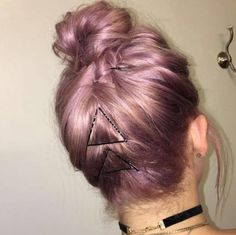 7 Gym Hairstyles That Are Actually Cute & Easy To Do   2. The Accessorized Topknot (pictured)