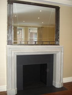 Custom marble fireplace and a 1930's French Art Deco, iron framed mirror..  A perfect fit!