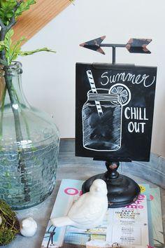 Cute summer chalkboard idea. Lots of simple summer living room decorating ideas.